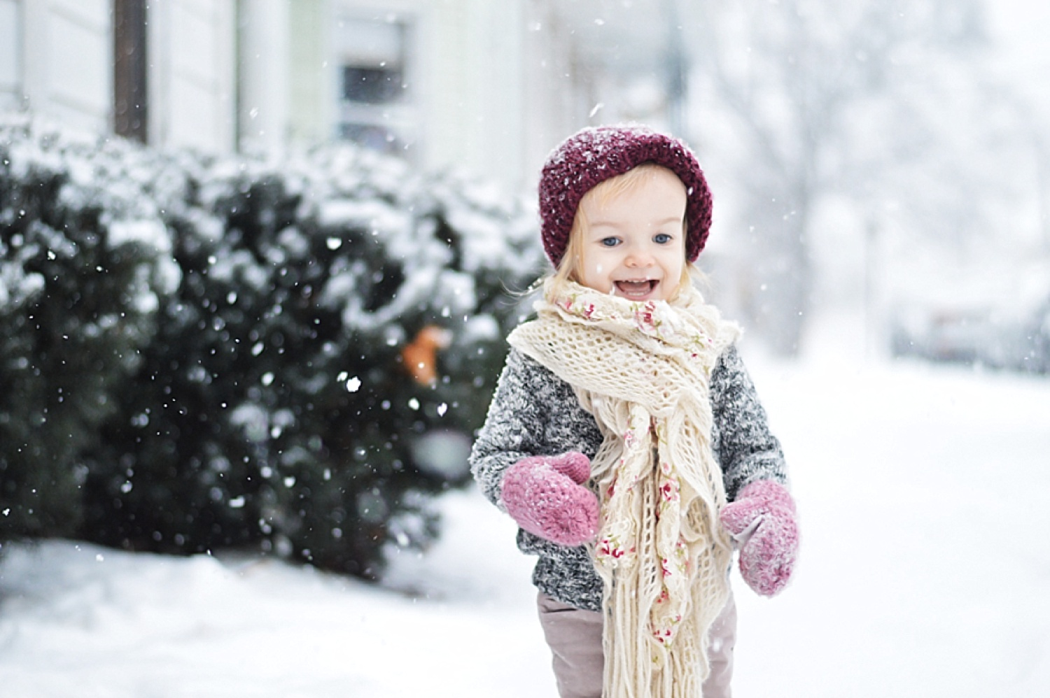 Baby girl playing in the snow with lifestyle mom blogger Rachael Burgess